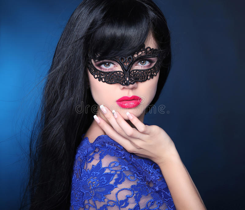 Healthy elegant hairstyle. Beautiful brunette girl model. Manicured nails. Beauty glamour woman wearing in venetian masquerade ca stock images
