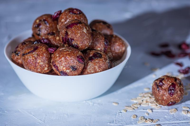 Healthy energy oatmeal balls or bites royalty free stock photo