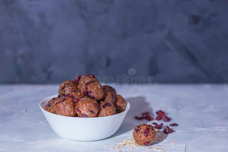 Healthy energy oatmeal balls or bites stock photos