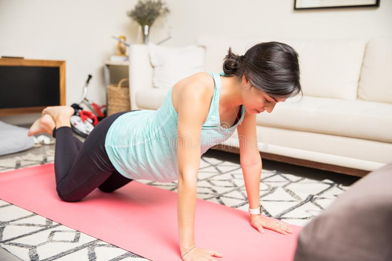 Healthy Expectant Mother Is Doing Knee Push-Ups On Yoga Mat stock images