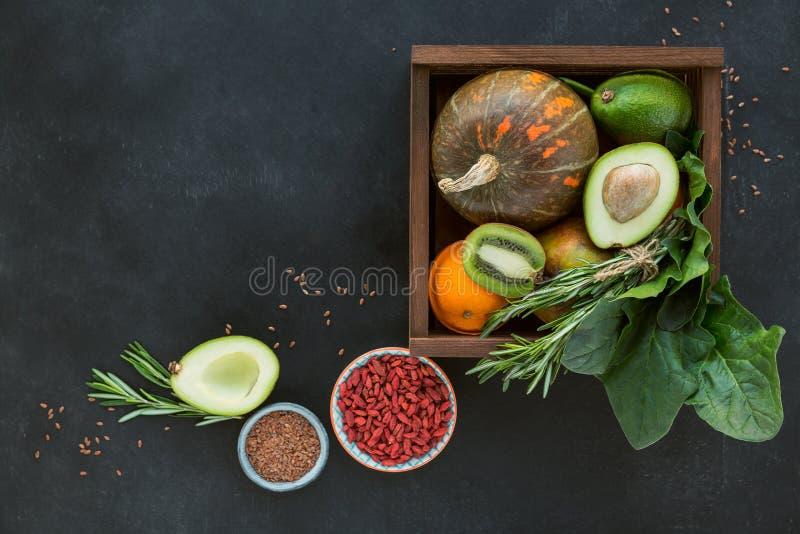 Healthy farmer organic food: fruit, vegetables, seeds, superfood, leaf stock photo