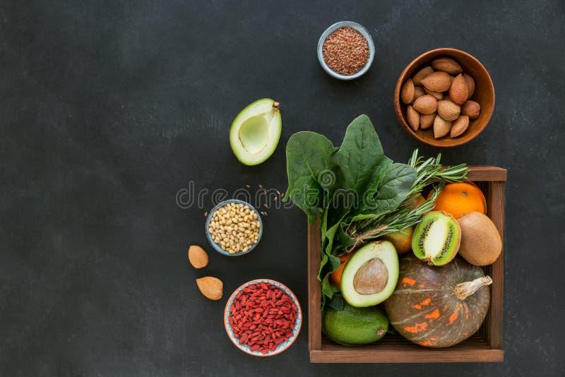 Healthy farmer organic food: fruit, vegetables, seeds, superfood, leaf royalty free stock photo