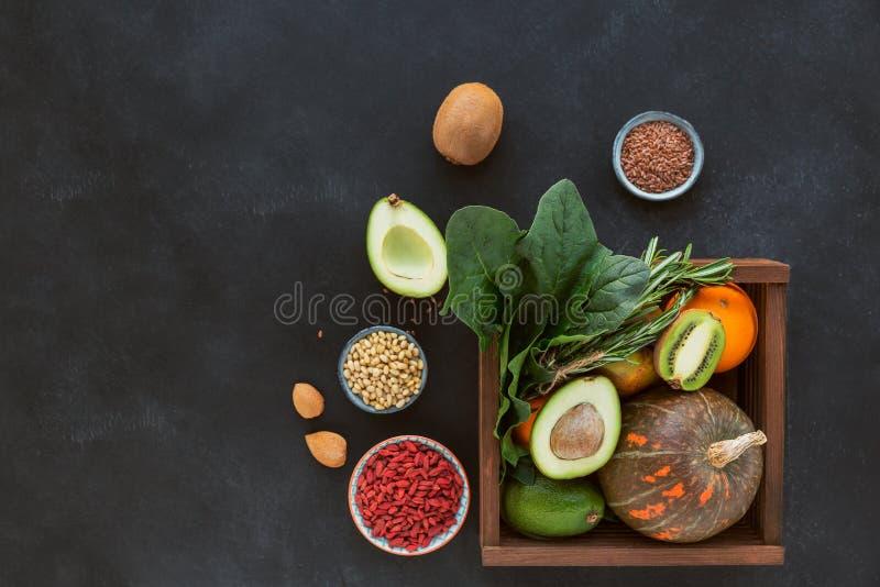 Healthy farmer organic food: fruit, vegetables, seeds, superfood, leaf stock photos