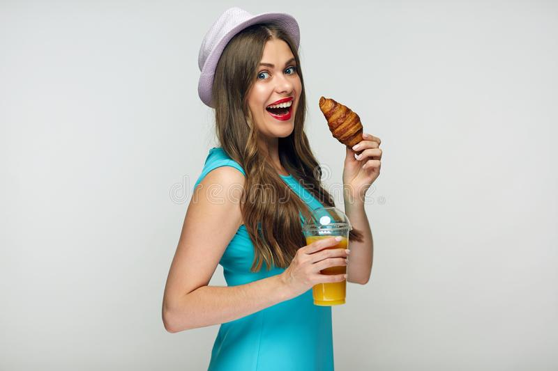 Healthy fast food for beautiful girl. Portrait of young woman royalty free stock photography