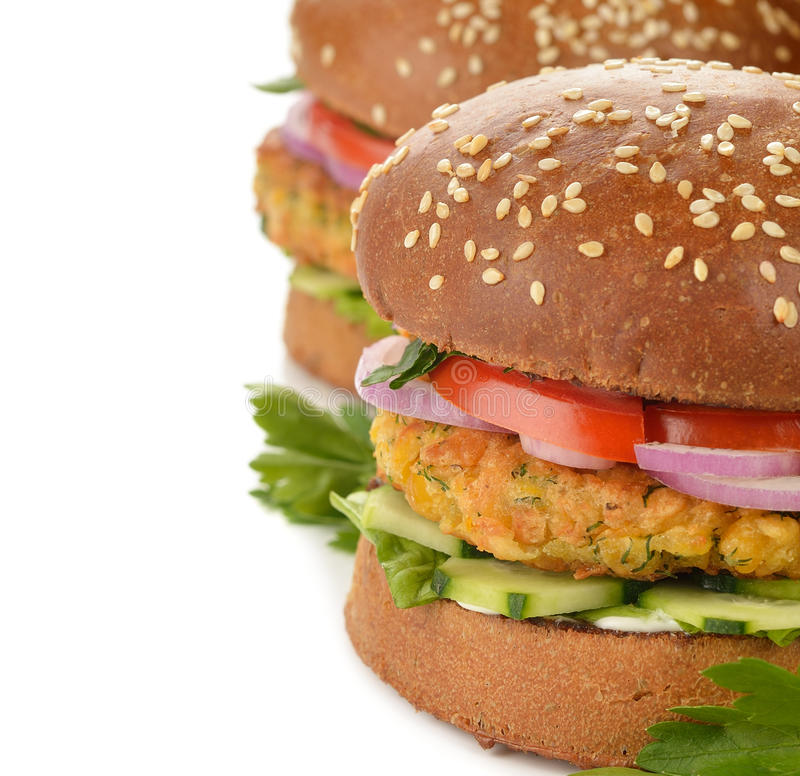 Healthy fast food, veggie burger with vegetables stock images