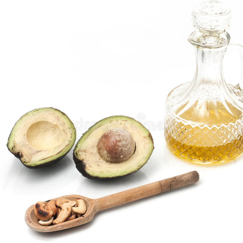 Healthy fats. Omega 3 source. Avocado, Olive Oil and Nuts stock photos