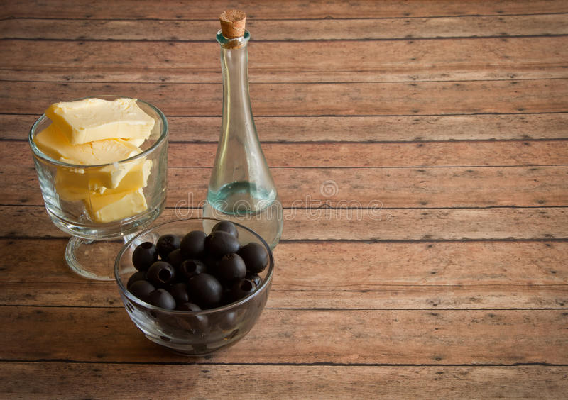 Healthy Fats of real butter, Olives and MCT and Coconut oil for. A Ketogenic Diet on a wood plank board stock image