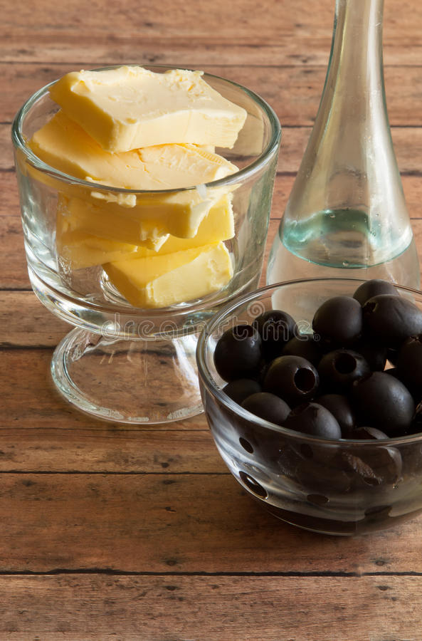 Healthy Fats of real butter, Olives and MCT and Coconut oil for. A Ketogenic Diet on a wood plank board stock images