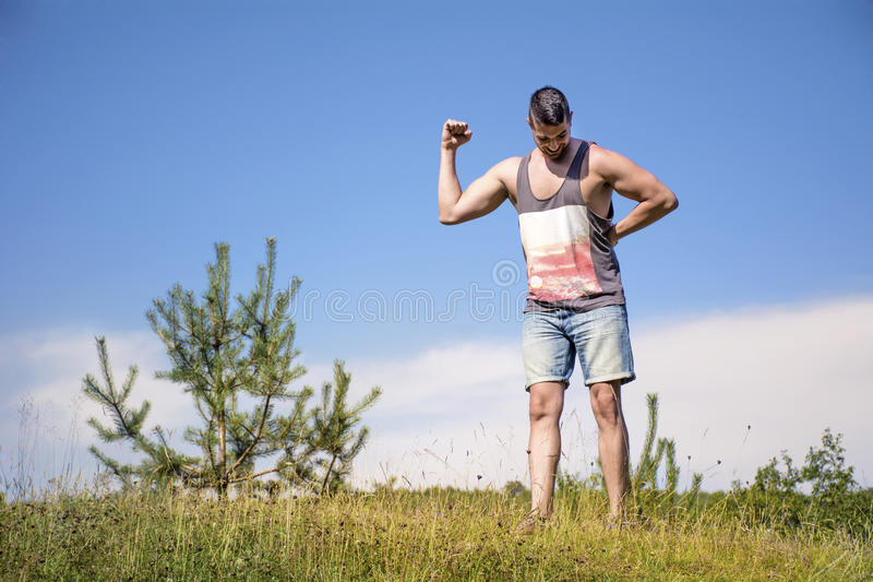 Healthy fit sportsman training and showing off his muscles stock photography