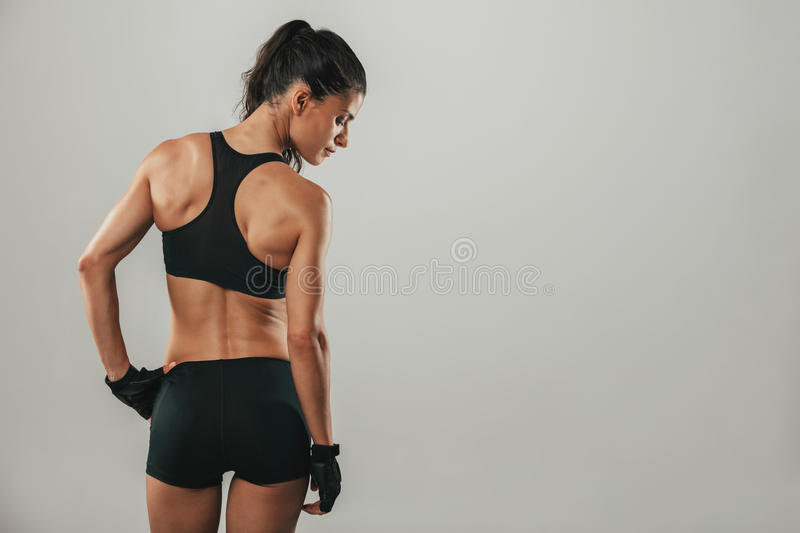 Healthy fit strong young woman in sportswear stock photo