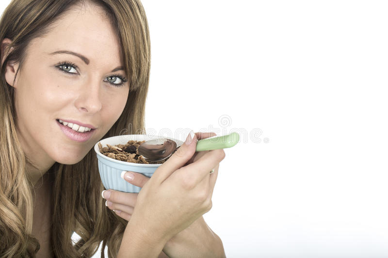 Healthy Fit Young Woman Eating Breakfast Cereals. Attractive Healthy Fit Young Woman Eating Breakfast Cereals stock photo