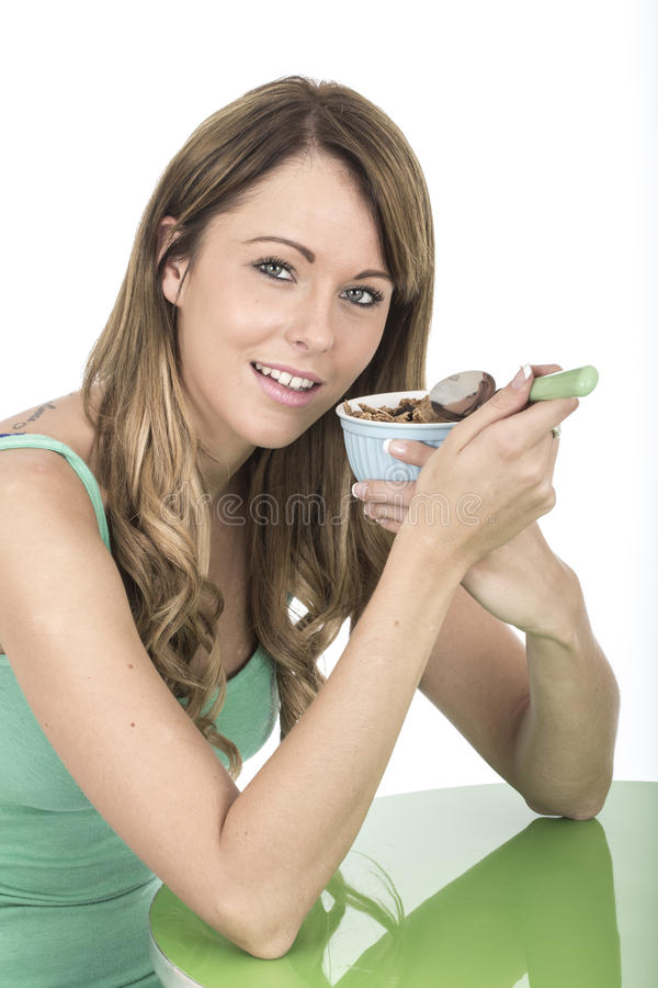 Healthy Fit Young Woman Eating Breakfast Cereals. Attractive Healthy Fit Young Woman Eating Breakfast Cereals stock photos