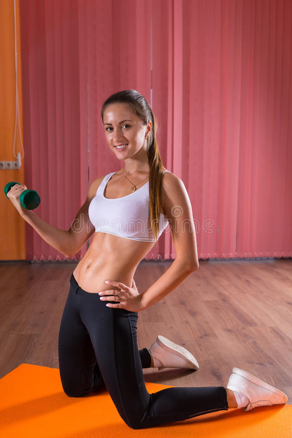 Healthy fit young woman lifting a weight royalty free stock images
