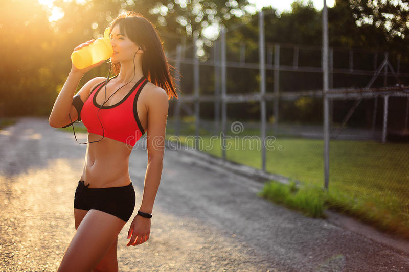 Healthy fitness girl with protein shake. stock images