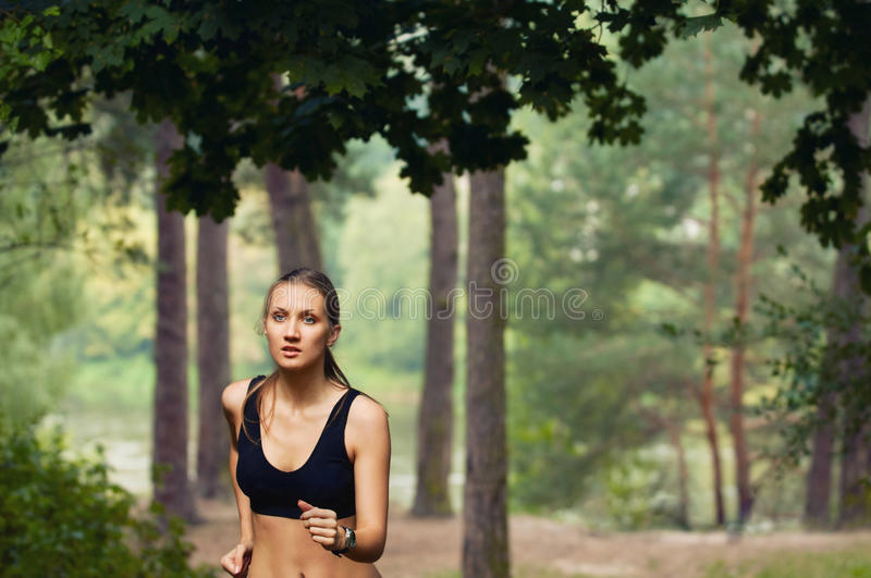 Healthy fitness sporty woman running early in the morning in for royalty free stock images