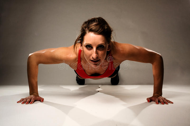 Healthy Fitness Woman Doing A Pushup Stock Images