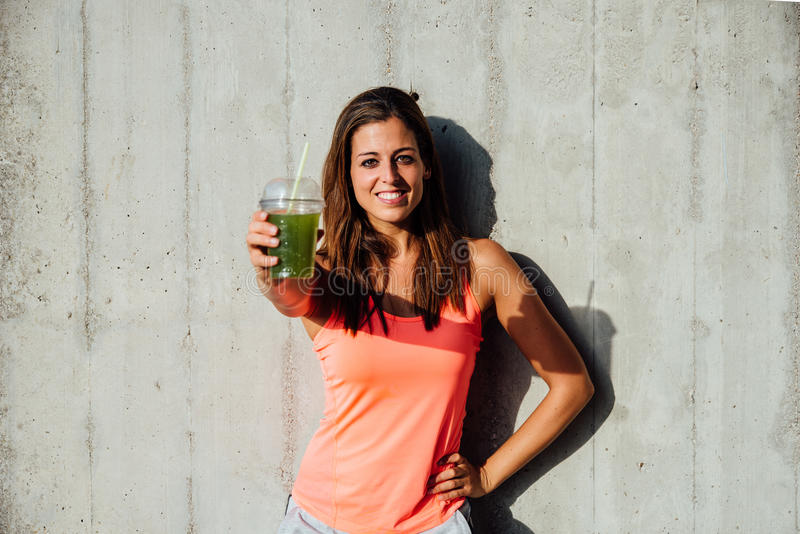 Healthy fitness woman holding detox smoothie stock photos