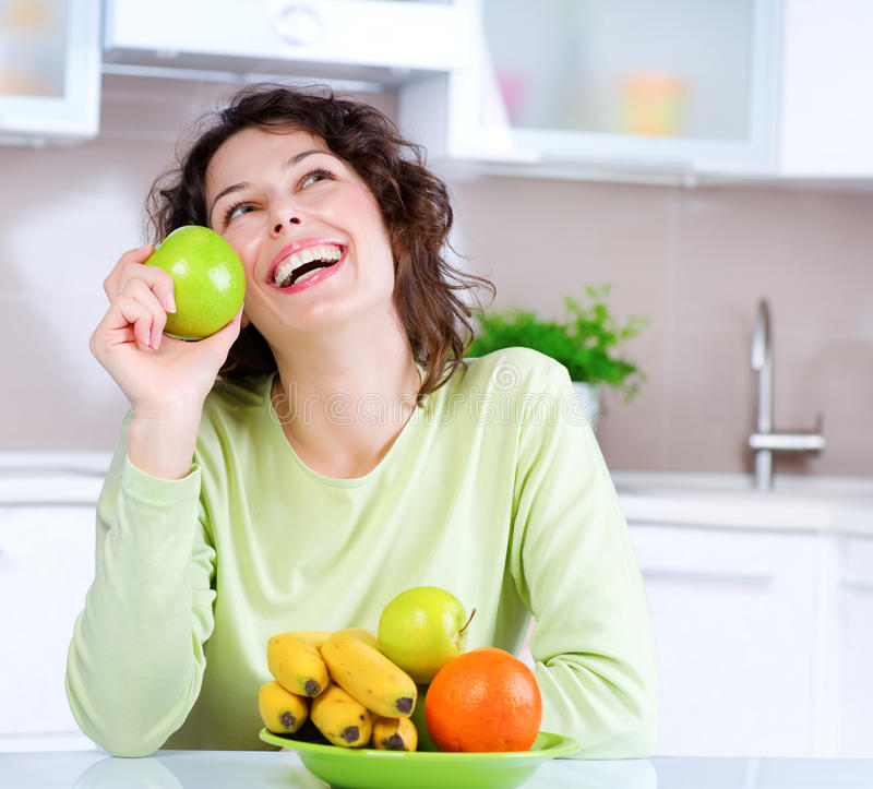 Healthy Food. Dieting concept. Healthy Food. Laughing Young Woman Eats Fresh Fruits royalty free stock photo