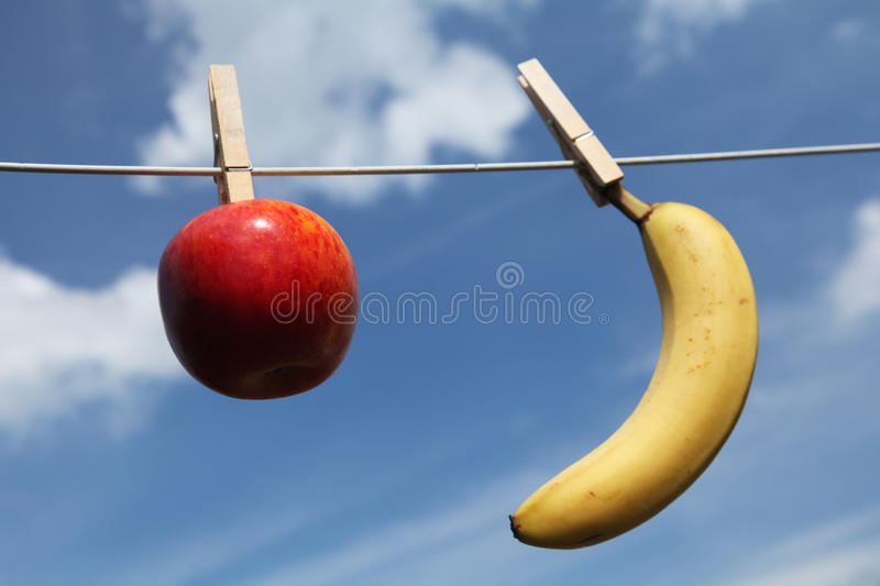 Healthy food. Hanging on a line with blue sky as background royalty free stock photo