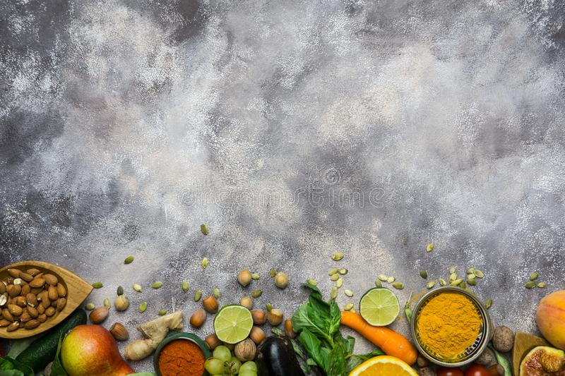 Healthy food background, frame of organic food. Ingredients for healthy cooking: vegetables, fruits, nuts, spices royalty free stock photography