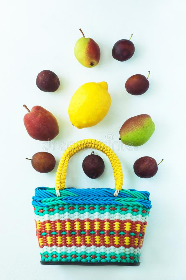 Healthy food in a basket. Zero waste concept, colorful reusable eco bags. Mix of different fruits on a white background, shopping packaging, top view, flatlay stock images