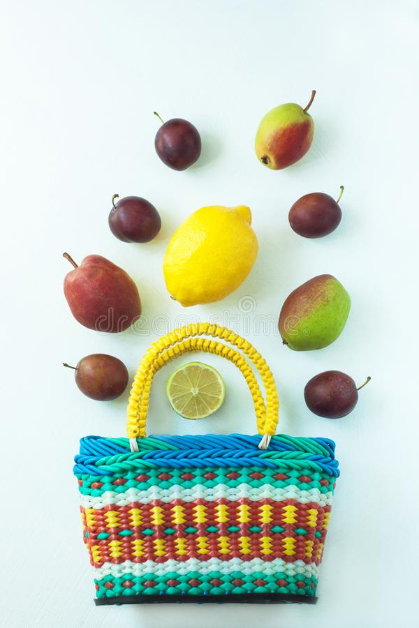 Healthy food in a basket. Zero waste concept, colorful reusable eco bags. Mix of different fruits on a white background, shopping packaging, top view, flatlay stock photography