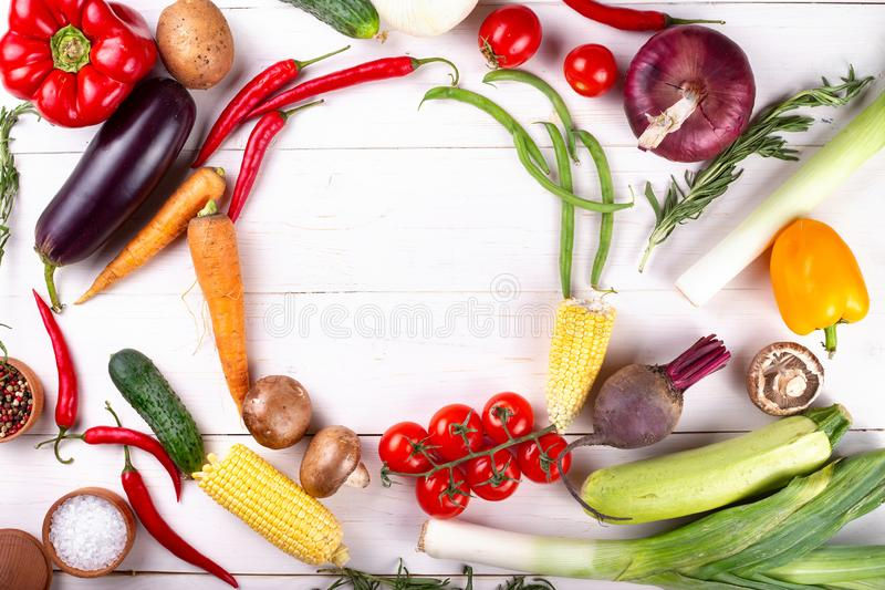 Healthy food.Big set of fresh vegetables on a wite background  . Vegan or diet food concept. Background layout with free text space royalty free stock image