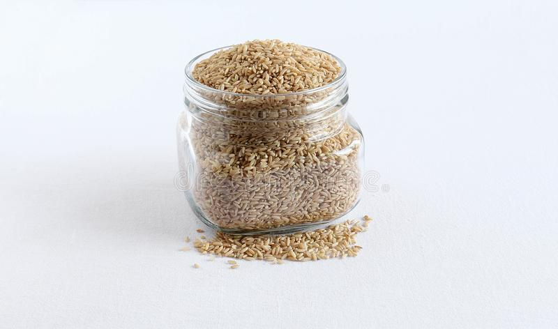 Healthy Food Brown Rice in a Bottle royalty free stock image