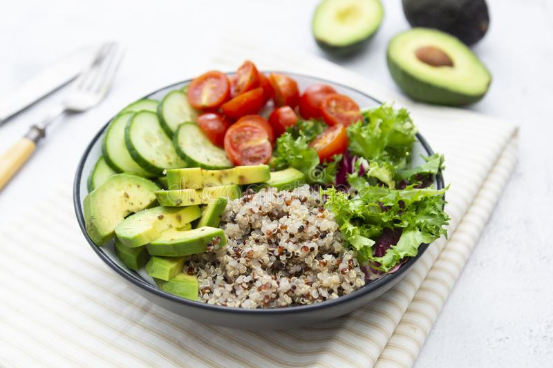 Healthy food. budha bowl with quinoa, avocado, cucumber, salad, tomatoe, olive oil. Clean eating, diet food. Bright background. Healthy food. budha bowl with stock images