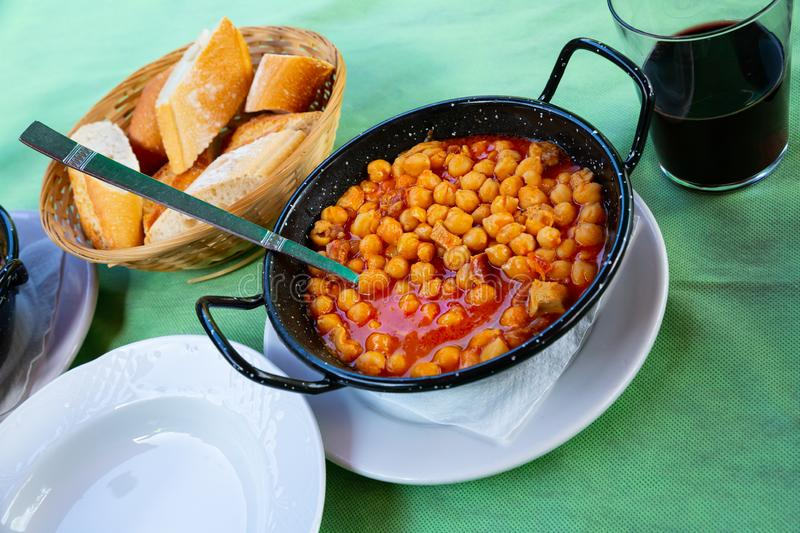 Healthy  food of chickpeas with tripe with red  sauces royalty free stock image