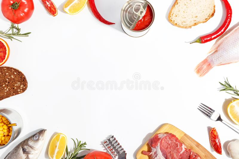 Healthy food clean eating selection: fruit, vegetable, seeds, fish, meat, leaf vegetable on white background. Top view. Organic fresh vegetables avocado tomato royalty free stock images