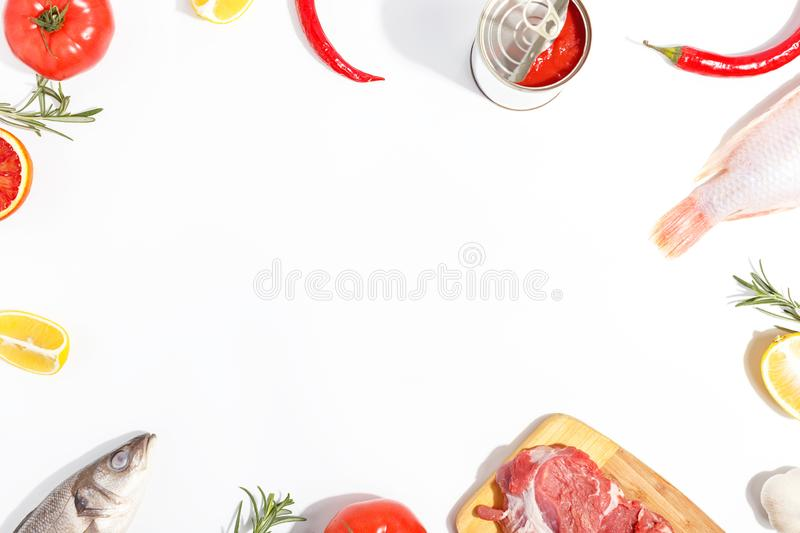 Healthy food clean eating selection: fruit, vegetable, seeds, fish, meat, leaf vegetable on white background. Top view. Organic fresh vegetables avocado tomato royalty free stock photography