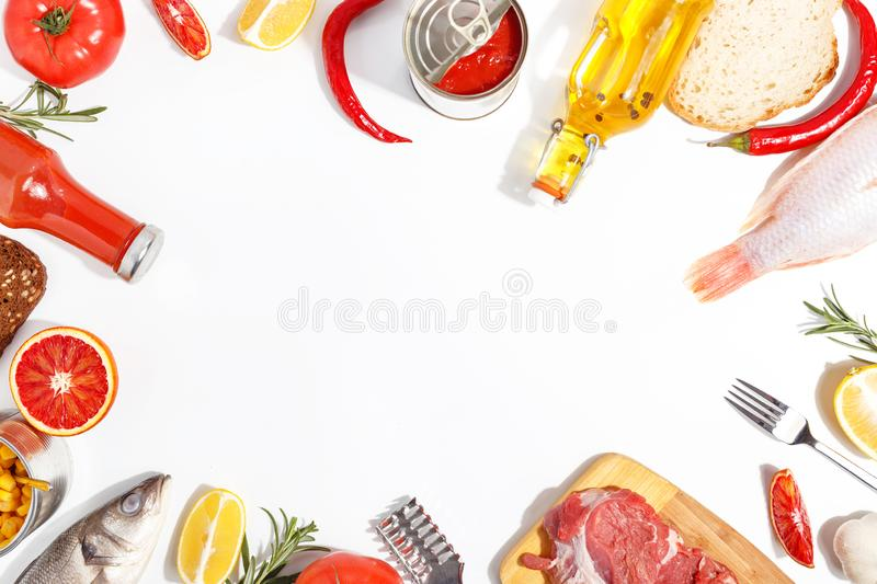 Healthy food clean eating selection: fruit, vegetable, seeds, fish, meat, leaf vegetable on white background. Top view. Organic fresh vegetables avocado tomato royalty free stock photos