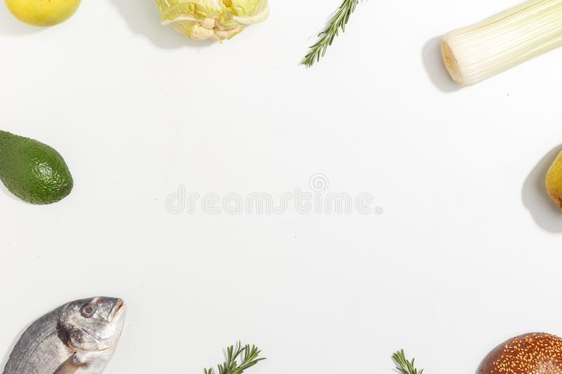 Healthy food clean eating selection: fruit, vegetable, seeds, fish, meat, leaf vegetable on white background. Top view. Copy space. Organic fresh vegetables stock images