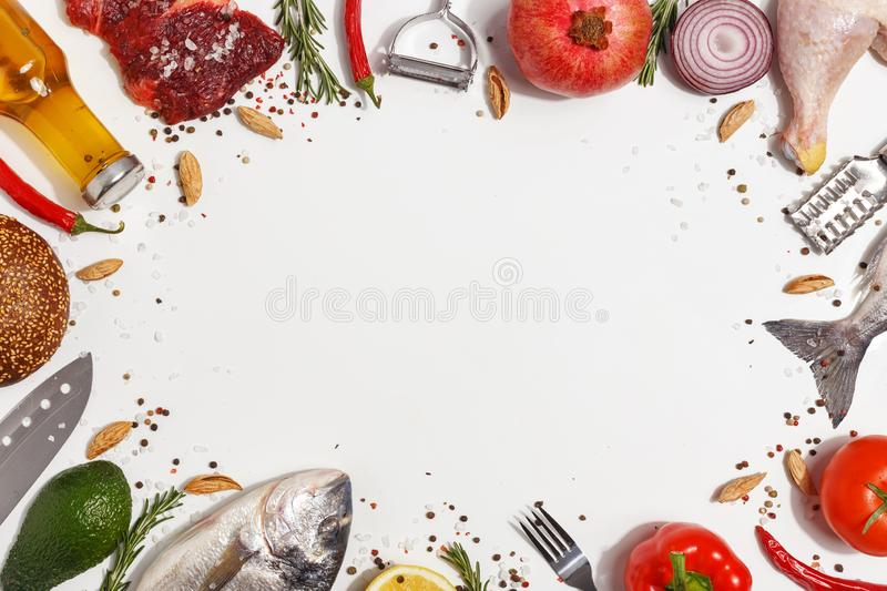 Healthy food clean eating selection: fruit, vegetable, seeds, fish, meat, leaf vegetable on white background. Top view. Copy space. Organic fresh vegetables stock photo