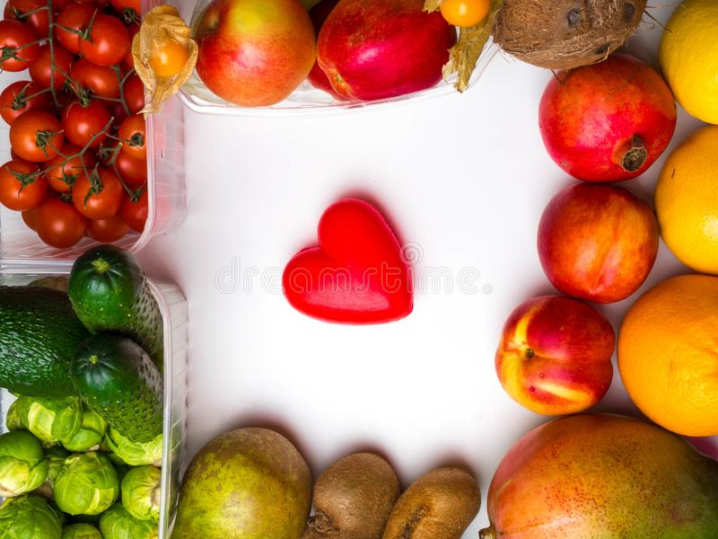 Healthy food clean eating selection: fruit, vegetable, superfood, copy space. On white background with red heart stock photography