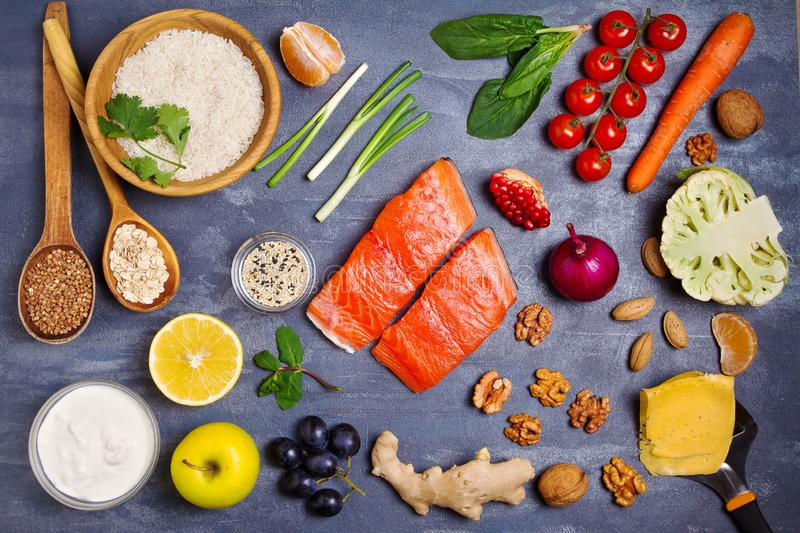 Healthy food clean eating selection: salmon fish, fruits, vegetables, cereals stock photography
