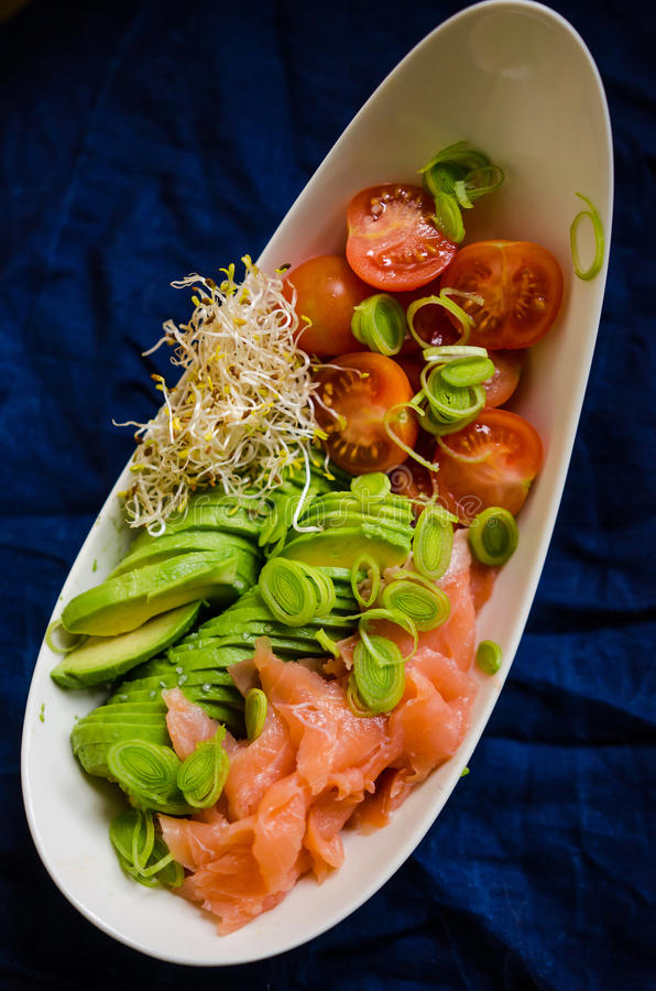 Healthy food- closeup. Healthy food: avocado, leek, salmon, sprouts and tomatoes royalty free stock images