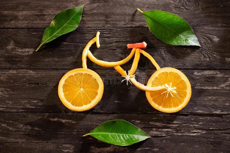 Healthy food concept of bicycle in detail made of fresh fruits f royalty free stock photos
