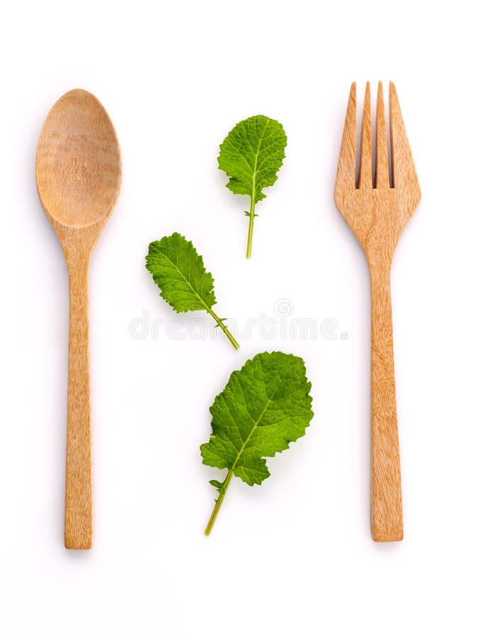 Free Healthy Food Concept Fresh Organic Green Leaves With Wooden Fork Royalty Free Stock Image - 62527696