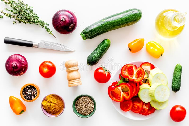 Healthy food concept. Ingredients for vegetable stew. Squash, bell pepper, tomato, spices, oil on white background top royalty free stock photos