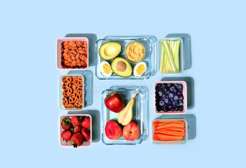 Healthy food concept, lunch boxes filled with fresh snacks stock photos