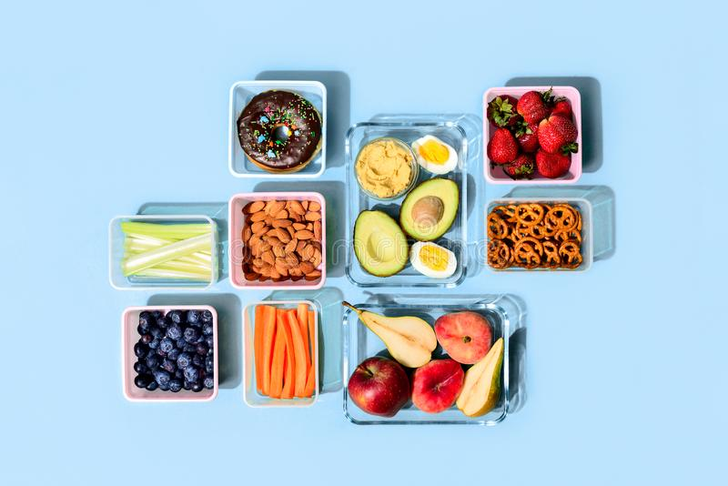 Healthy food concept, lunch boxes filled with fresh snacks stock photography