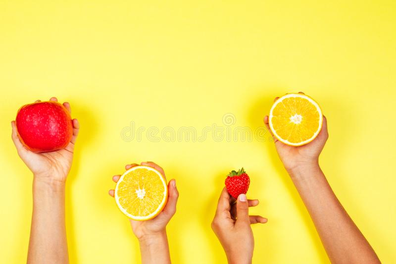 Healthy food concept. Many kids hands with fuits. Top view royalty free stock images