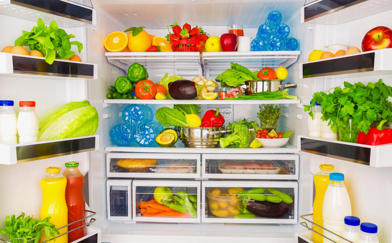 Healthy food concept. Open fridge full of fresh fruits and vegetables, healthy food background, organic nutrition, health care, dieting concept stock photos