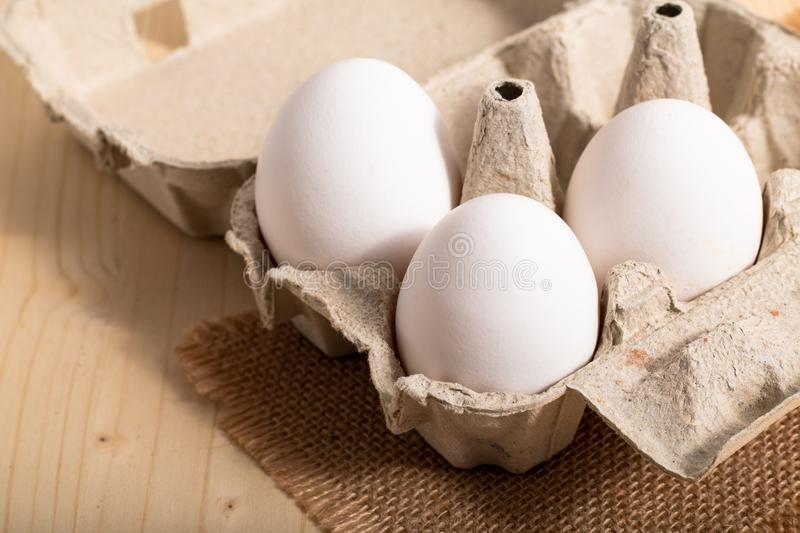 Healthy Food concept Organic eggs in paperboard cartons stock photos