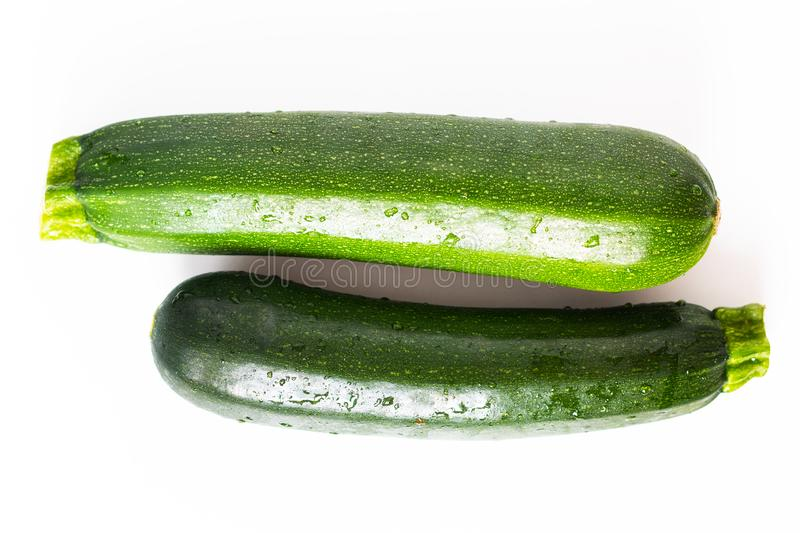 Healthy food concept organic green Zucchini or courgette isolated on white background stock photos
