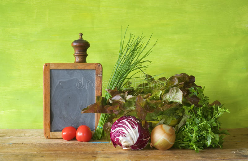 Healthy food concept. Salads,herbs and vegetables with a blackboard for your copy, healthy food concept stock photos