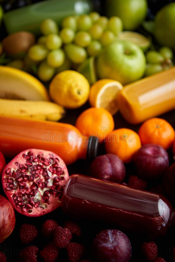 Healthy food concept. Various mixed fruits, vegetables and juices formed in rainbow royalty free stock photos