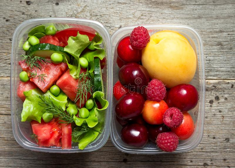 Healthy food, cooked in containers, vegetables and fruits. Shallow DOF royalty free stock images